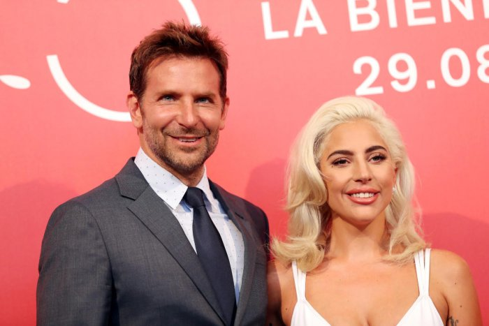 """The 75th Venice International Film Festival - Photocall for the film """"A Star is Born"""" out of competition - Venice, Italy, August 31, 2018 - Director and actor Bradley Cooper with actor Lady Gaga. REUTERS"""
