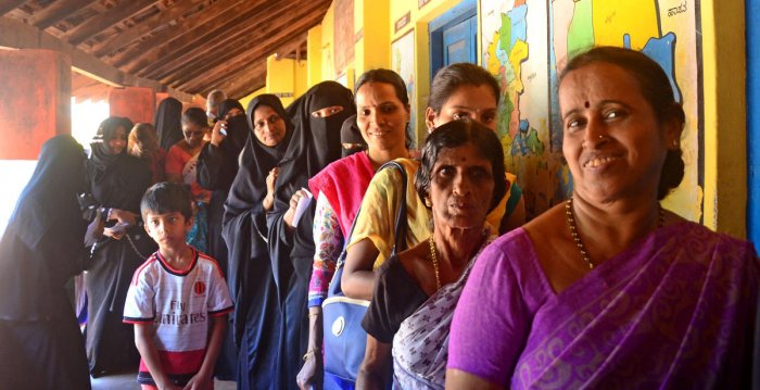 Women voters wait for their turn at Bharat English medium school at Ombattukere polling booth in Ullal on Friday.