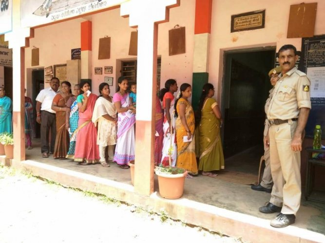 Voters wait for their turn to exercise their franchise in Kundapura TMC limits.