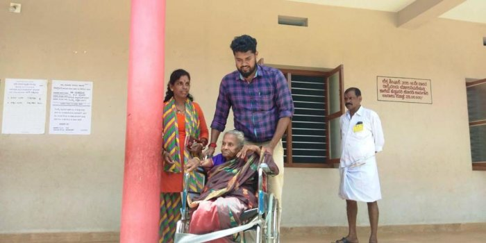 An aged woman being brought to exercise her franchise at Saligrama Town Panchayat jurisdiction.