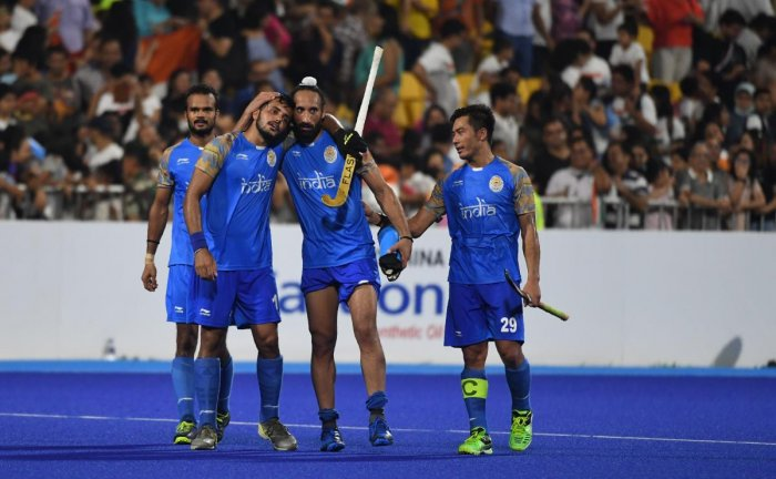 India's team members celebrate after winning the match against Pakistan during the men's hockey bronze medal match. AFP