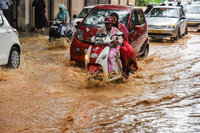 Urban experts point out that preventing transporting of water to low-lying areas will stop flooding. DH Photo by S K Dinesh