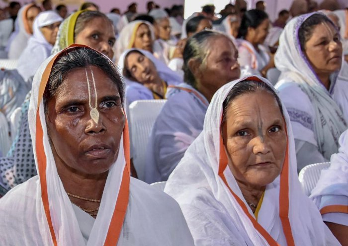 Widows attend the inauguration programme of Krishna Kutir, a home for 1000 widows, in Vrindavan near Mathura on Friday, Aug 31, 2018. (PTI Photo)