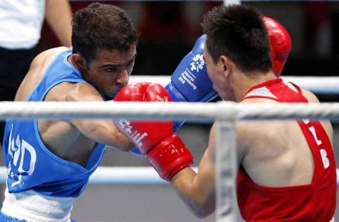 India's Amit Panghal (left) and Hasanboy Dusmatov of Uzbekistan fight it out in the final of the Men's Light Fly in Jakarta on Saturday. REUTERS