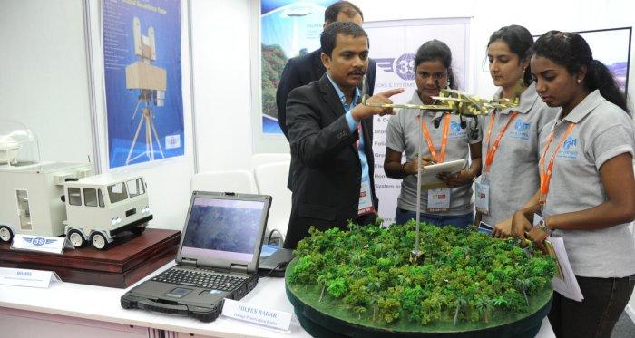 One of the start-up company team explaining on Folper Midders Poliage penetation at the Start Up tech expo 2018 at ITI limited at Dooravaninagar in Bengaluru on Saturday. (DH Photo/Srikanta Sharma R)