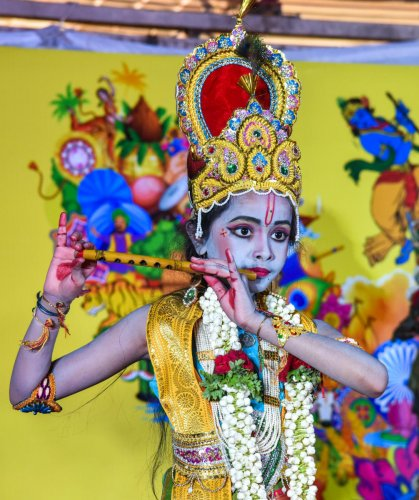 A child dressed up as Lord Krishna as part of the Janmashtami celebrations organised by Iskcon at Tripura Vasini, Palace Grounds, on Sunday. DH Photo/S K Dinesh