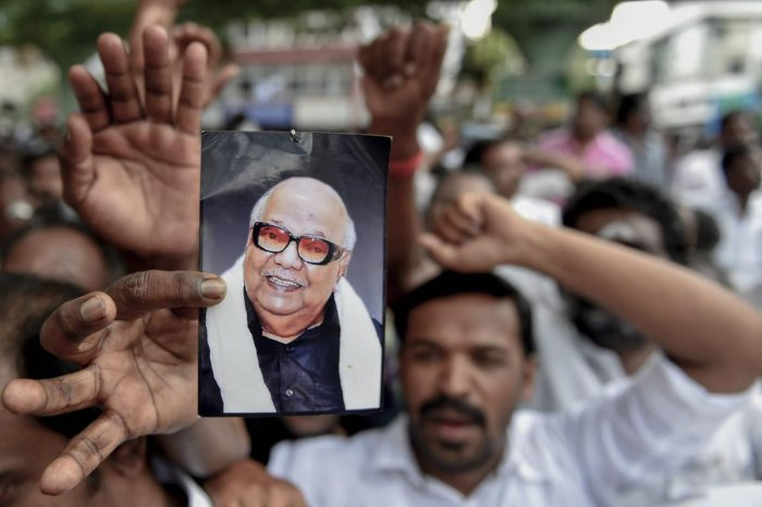 Dravida Munnetra Kazhagam (DMK) supporters gather outside the hospital, where DMK chief M Karunanidhi is being treated, in Chennai on Monday, July 30, 2018. (PTI Photo)