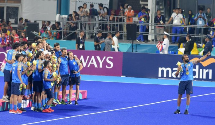 Indian men's hockey team captain Sreejesh takes selfie with their bronze medals during the medal ceremony at the 18th Asian Games 2018, in Jakarta. (PTI Photo)