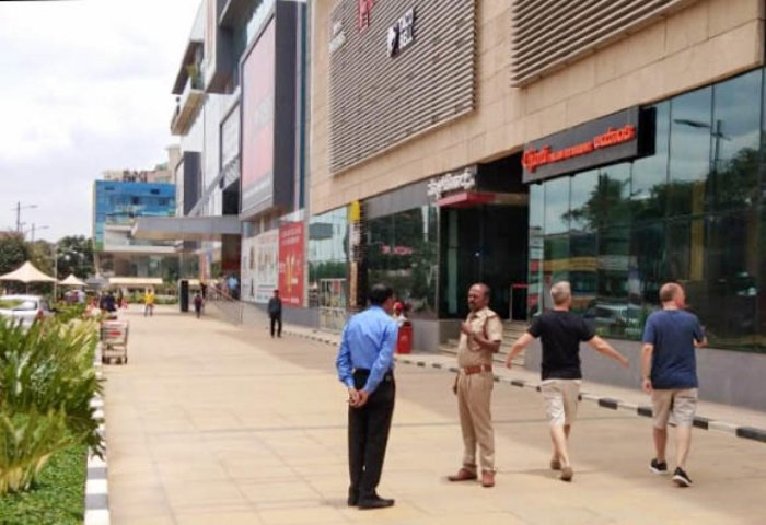 Fire department officials cleared two-wheeler parking and shops on the driveway at Golden Heights mall in Rajajinagar. Photo by Fire and Emergency Services