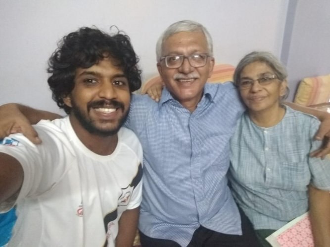 Vernon Gonsalves, with wife Susan Abraham and son Sagar Abraham-Gonsalves, minutes before he was arrested by the Pune Police last week.