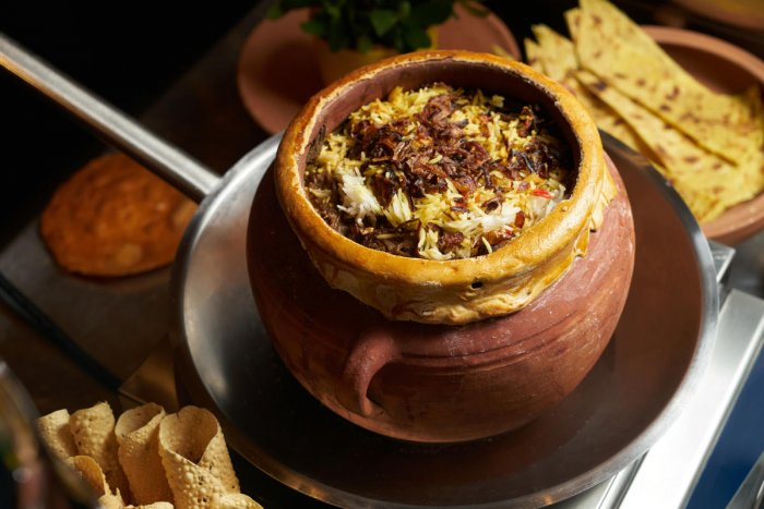 Pilaf rice with meat and vegetables. Delicious Indian food Hydrabadi soya chunks Biryani vegetable soy Pilaf served in clay pot. Healthy food