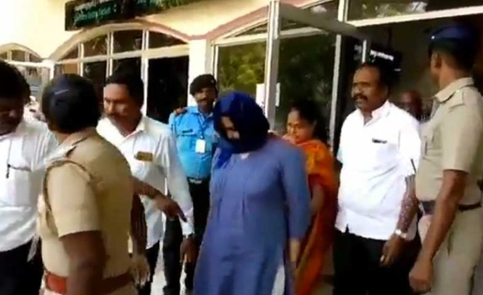 Lois Sophia being escorted out of Tuticorin airport. Screengrab.