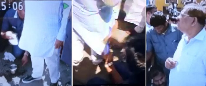 Video grab of Deputy chief minister Dr. G Parameswara's gunman cleaning Parameswara's Kurta and Shoe which was became duerty during his Shivajinagar area city rounds visit in Bengaluru on Tuesday.