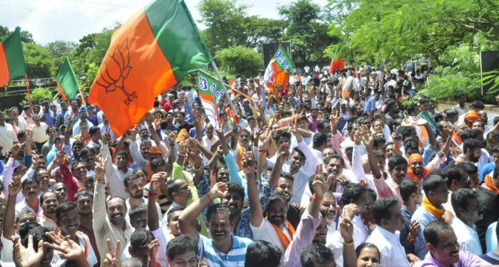 BJP workers celebrate the party's good show in the CMC elections in Udupi on Monday. DH Photo