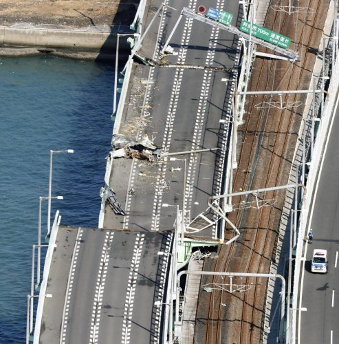 The bridge connecting Kansai International Airport in Osaka, western Japan, Wednesday, a day after a tanker slammed into its side by a powerful typhoon. About 3,000 passengers stranded by Typhoon Jebi overnight at the offshore Japanese airport begun retur