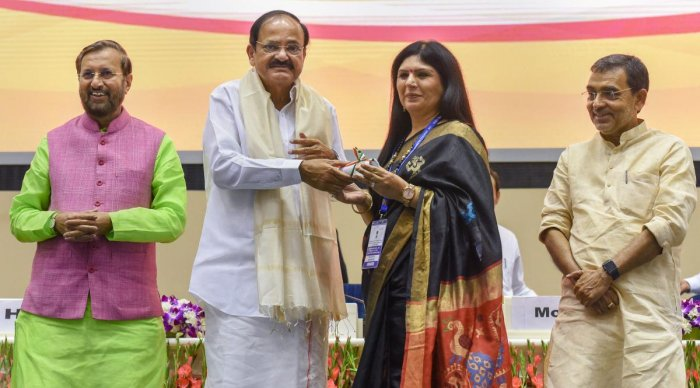Vice President M Venkaiah Naidu felicitates a teacher at the Shikshak Diwas 2018 (Teacher's Day) function in New Delhi, Wednesday. HRD Minister Prakash Javadekar and Minister of State Upendra Kushwaha are also seen. PTI