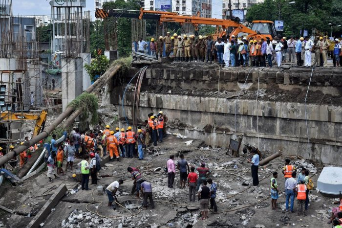 NDRF, DGM and fire personnel during the rescue operations after the collapse of Majerhat bridge, in Kolkata, Wednesday, Sept 5, 2018. (PTI Photo)