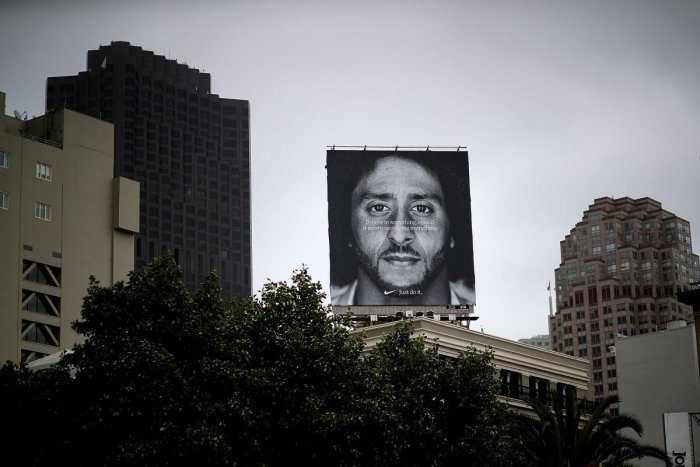 """Nike has unveiled its first """"Just Do It"""" ad narrated by Colin Kaepernick, a spot scheduled to air during the NFL season opener on Thursday night. (AFP Photo)"""