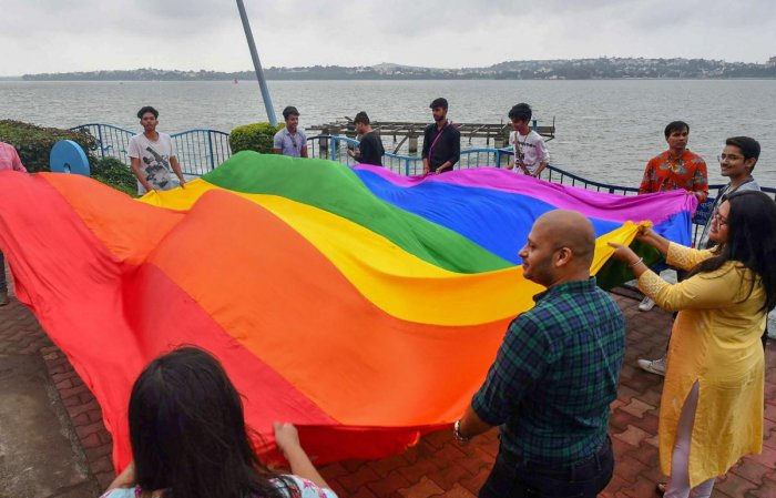 LGBTQ members celebrate the Supreme Court verdict which decriminalises consensual gay sex on the bank of Upper Lake, in Bhopal. (PTI Photo)