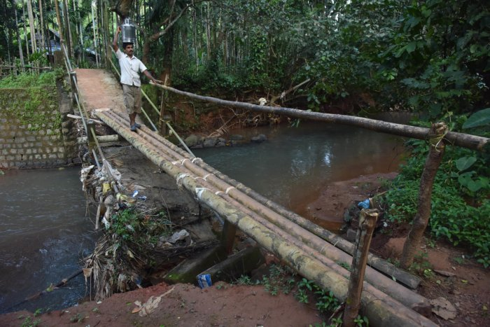 Villagers of Nooji Halabe in Manchi grama at Bantwal using a temporary bridge made of bamboo. The old bridge was collapsed on Tuesday September 03, 2018 due to heavy rain. Photo/Janardhan BK