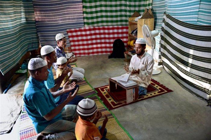 Rohingya Muslim refugees offering prayers at a camp at Kelambakkam in Chennai. PTI file photo