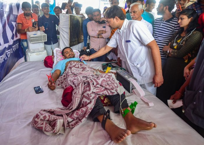 A doctor checks the health of Patidar Anamat Andolan Samiti (PAAS) leader Hardik Patel on the 7th day of his indefinite hunger strike for reservation, in Ahmedabad on Friday, Aug 31, 2018. (PTI Photo)