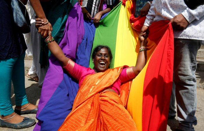 An activist of lesbian, gay, bisexual and transgender (LGBT) community celebrates after the Supreme Court's verdict of decriminalizing gay sex. REUTERS