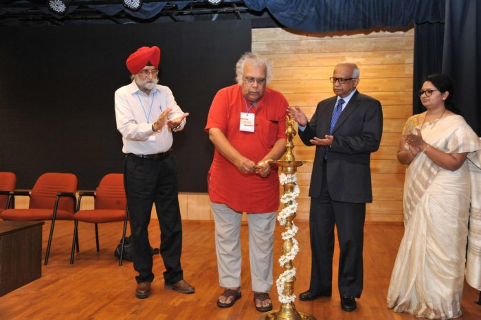 Kannada poet and playwright Prof H S Shivaprakash lighting the lamp at MILAP, at Manipal on Thursday.