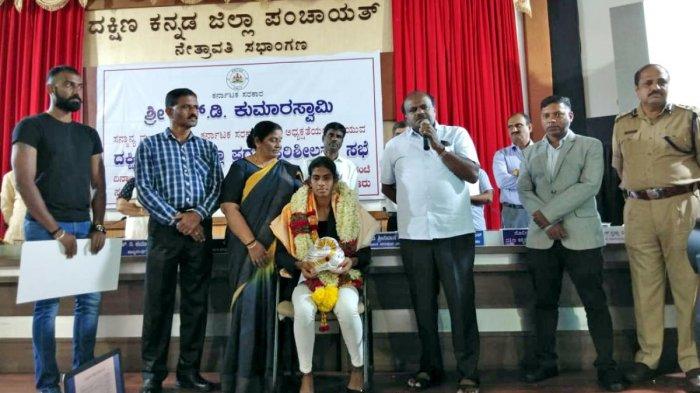 Chief Minister H D Kumaraswamy speaks after felicitating olympian M R Poovamma.