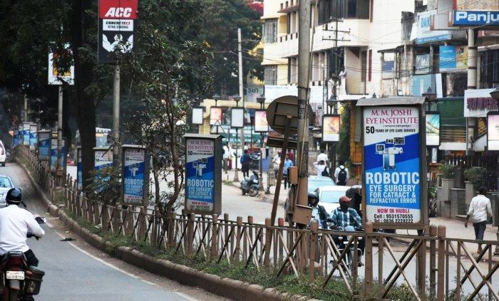 Advertisement boards on the road median on Lamington Road in Hubballi.