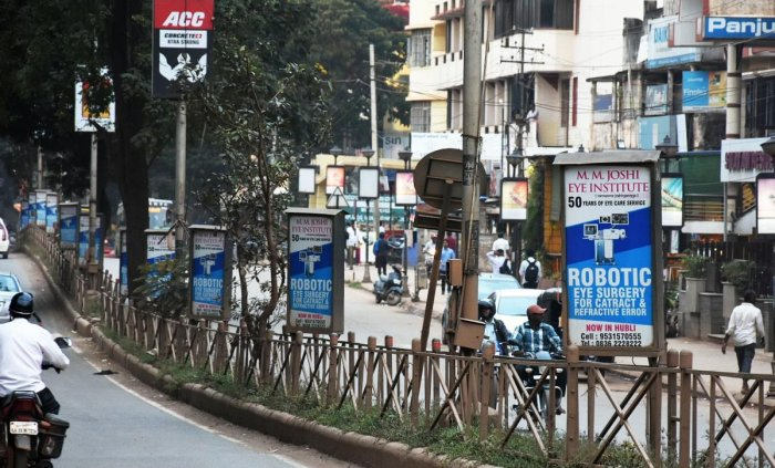 Advertisement boards on the road median on Lamington Road in Hubballi.