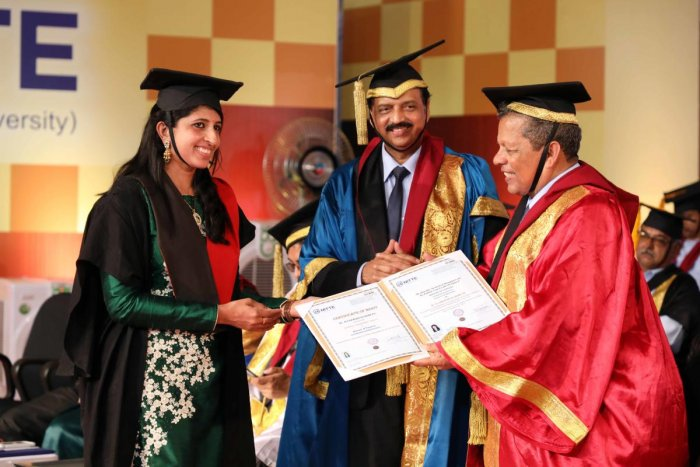 A student receives her degree from Nitte Deemed to be University Chancellor N Vinay Hegde during the convocation at Deralakatte on Saturday.