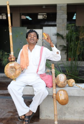 Gifted: Folk musician Ramaiah rendering a song. Photo by Satish Badiger