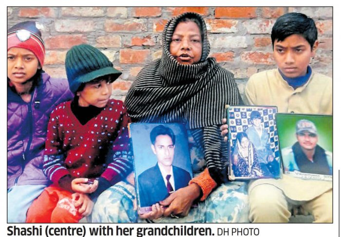 Shashi Devi of Maqbolpura village in Amritsar district, who lost her three sons to drugs, with her grandchildren. dh photo