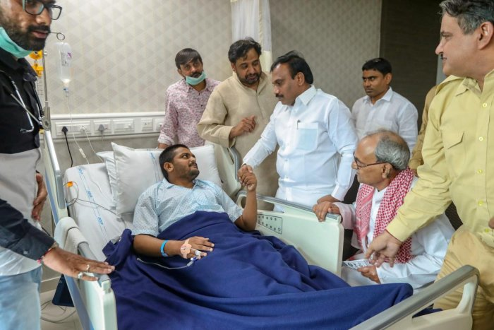 Janta Dal United's former president Sharad Yadav meets PAAS leader Hardik Patel, who has been on an indefinite hunger strike for reservation since Aug 25, in Ahmedabad. (PTI Photo)