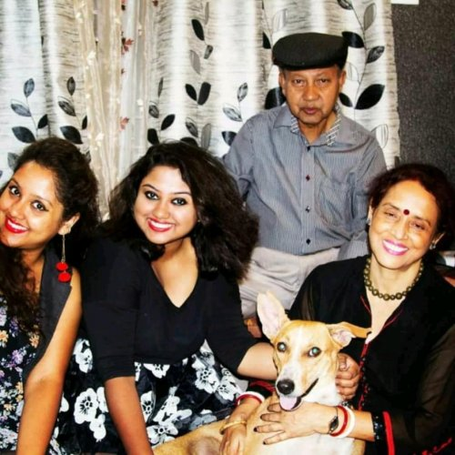 The author (first from left) and family with Doggu.