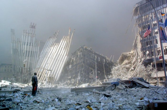In this file photo taken on September 11, 2001, a man stands in the rubble, and calls out asking if anyone needs help, after the collapse of the first World Trade Center Tower in New York. - Seventeen years later, more than 1,100 victims of the hijacked plane attacks on the World Trade Center have yet to be identified. (AFP File Photo)