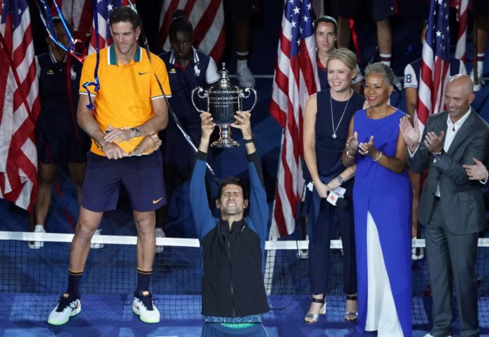 Novak Djokovic of Serbia celebrates his victory over Juan Martin del Potro of Argentina (L) after their 2018 US Open men's singles final match on September 9, 2018 in New York. (AFP Photo)
