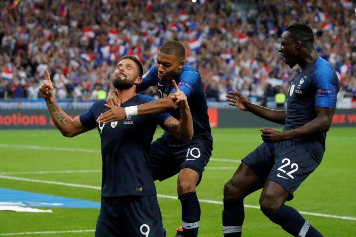 DROUGHT ENDS! France's Olivier Giroud (left) celebrates with Kylian Mbappe and Benjamin Mendy after scoring the equaliser against Netherlands. Reuters
