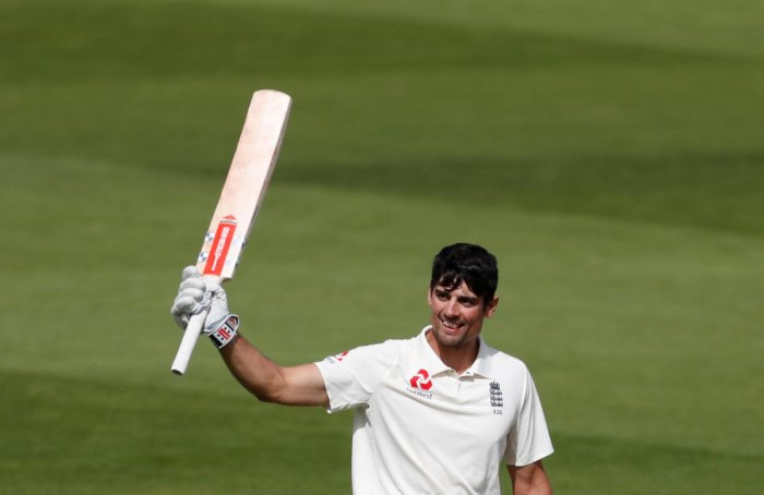 England's Alastair Cook celebrates after reaching his century. Reuters