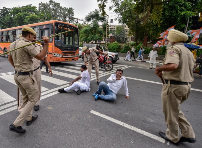 Policemen lathi-charge on members of Indian Youth Congress who were taking part in a protest march during the 'Bharat Bandh', called against fuel price hike and depreciation of the rupee, in New Delhi, Monday, Sept. 10, 2018. PTI Photo