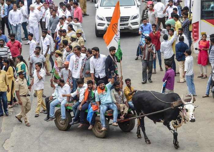 Congress party workers ride on a bullock-cart during the 'Bharat Bandh' called against fuel price hike and devaluation of the rupee, in Bengaluru, Monday, Sept 10, 2018. PTI Photo