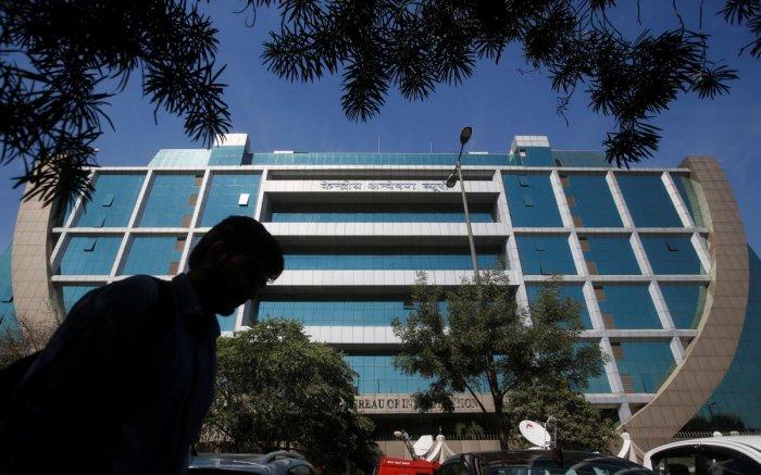 A man walks past the Central Bureau of Investigation (CBI) headquarters, in New Delhi. (Reuters file pic)