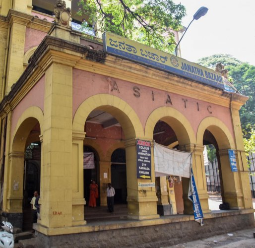 Bengalureans have come forward to protect the 83-year-old Asiatic Building housing the Janatha Bazaar on KG Road. DH FILE PHOTO