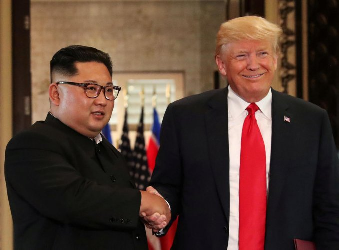 U.S. President Donald Trump and North Korea's leader Kim Jong Un shake hands after signing documents during a summit at the Capella Hotel on the resort island of Sentosa, Singapore, June 12, 2018. REUTERS/Jonathan Ernst/File Photo