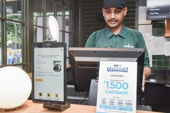 Chai Point, Church Street uses AI. The cashier does not take the customer's contact details as the device at his counter automatically recognises their face. DH Photo by S K Dinesh