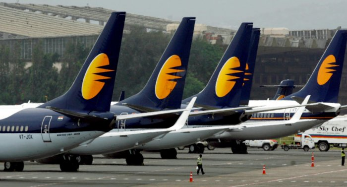 FILE PHOTO: Jet Airways aircraft stand on tarmac at the domestic airport terminal in Mumbai. Reuters