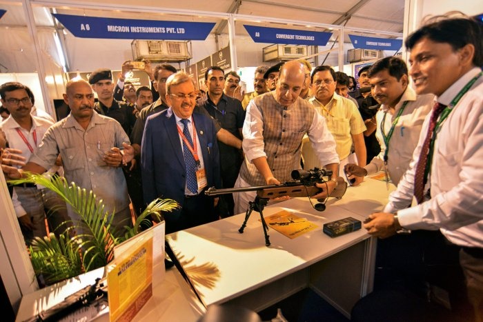 Home Minister Rajnath Singh visits a stall at 'Defence & Homeland Security Expo and Conference', in New Delhi on Thursday. PTI