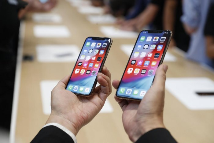 A man holds the newly released Apple iPhone XS and XS Max during a product demonstration following the Apple launch event at the Steve Jobs Theater in Cupertino, California, September 12, 2018. (REUTERS)