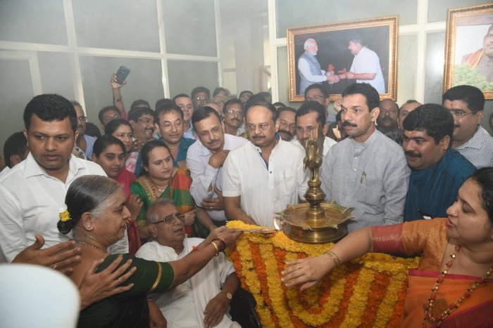 Mangaluru South MLA D Vedavyas Kamath's parents D Vaman Kamath and Tara V Kamath, inaugurate the new office of the legislator, at Mangaluru City Corporation building on Wednesday.
